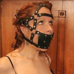 Black durable muzzle with a gag