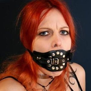 Black muzzle with a gag