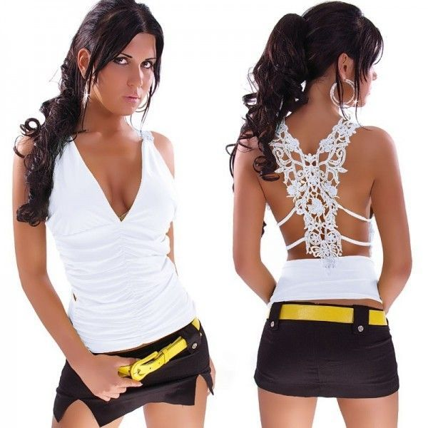 Adorable white top with lace applique on the back