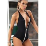 Combines a striking black swimsuit