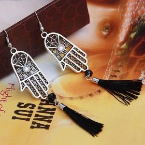 Earrings in the form of a palm with rhinestones and tassels