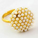 Golden ring with beads