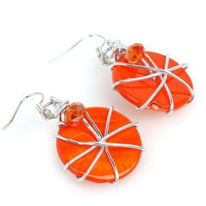 Earrings with orange round stones
