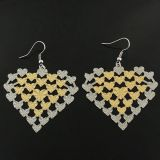 Two-tone earrings in the shape of a heart