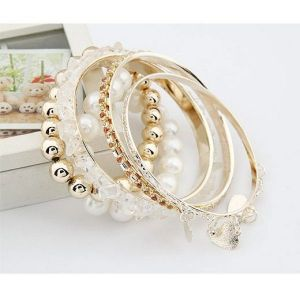 A stunning Golden bangle with beads (brown)