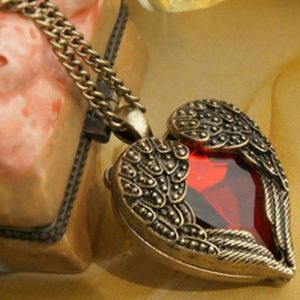 Necklace in heart shape with red stone