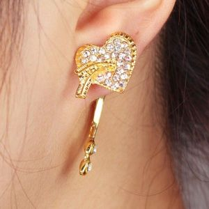 Golden earrings with a heart