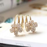 Золотистое кольцо-пружина с цветочками цена фото