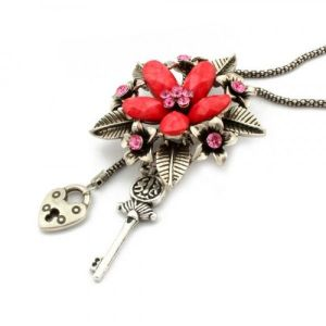 Metal necklace with flower design and shimmering rhinestones