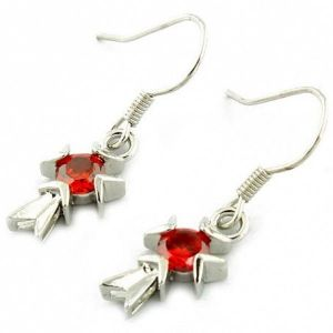Earrings with red stones in the shape of a cross