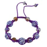 Stylish bracelet made of beads and rhinestones