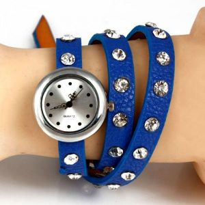 A miniature watch with strap and studs