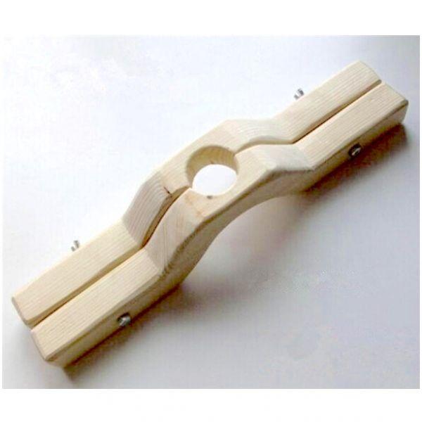 Деревянный фиксатор для мошонки