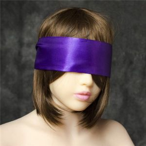Wide purple satin ribbon on the eyes in the form of a mask