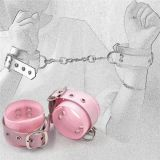 Pink handcuffs on a chain